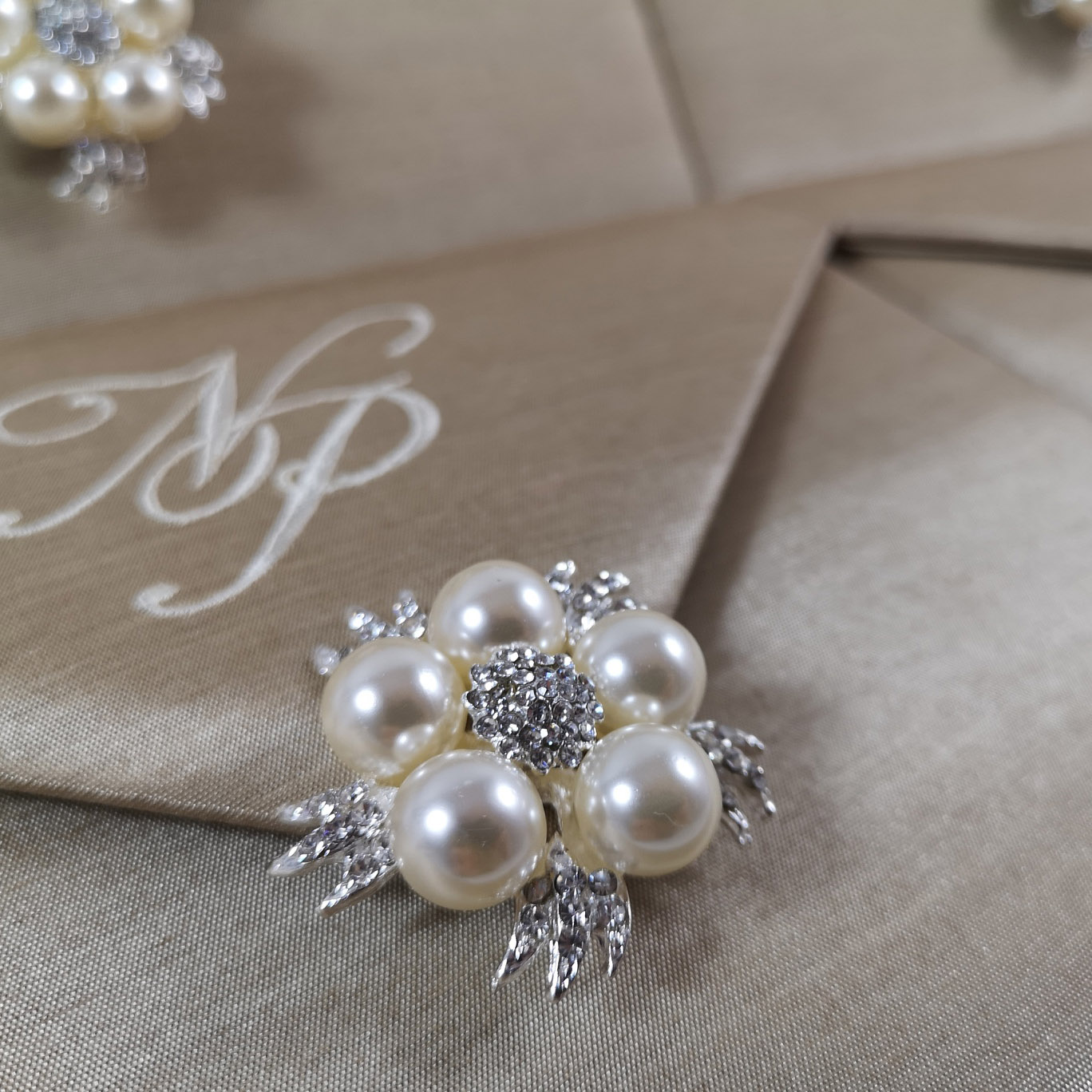 Elegant pearl brooch invitation envelope