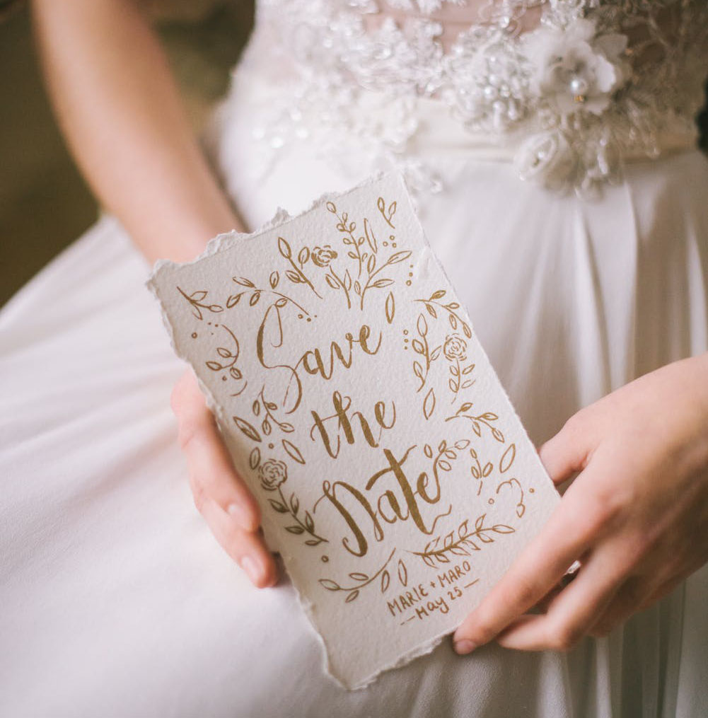 Bride holding one of our handmade save the date cards